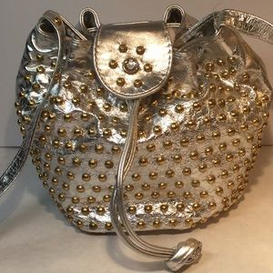Brilliant silver leather event bag with gold studs